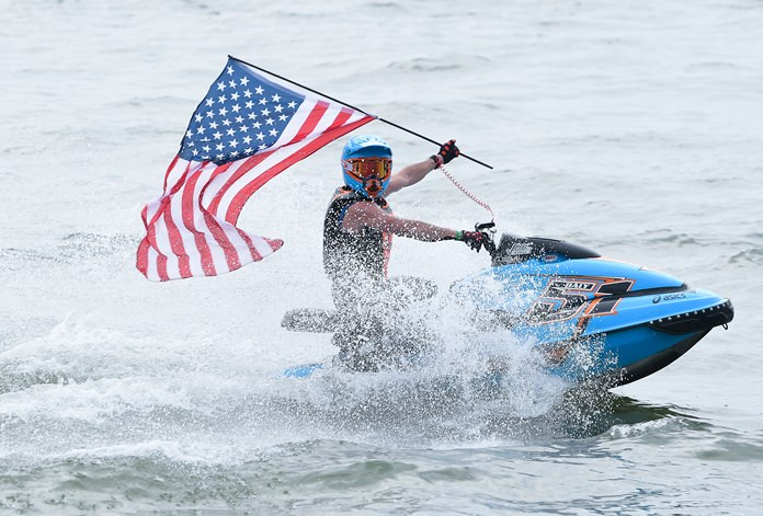 Christian Daly of the USA flies his nation's flag after winning the Pro Sport GP class at the Jet Ski World Cup event in Pattaya, Sunday, Dec. 9. (Photo/Naratip Golf Srisupab/SEALs Sports Images)