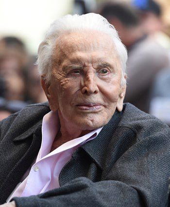 In this Nov. 6, 2018 file photo, actor Kirk Douglas attends a ceremony honoring his son actor Michael Douglas with a star on the Hollywood Walk of Fame in Los Angeles. (Photo by Chris Pizzello/Invision/AP)