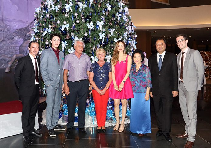 Royal Cliff Hotels Group Managing Director Panga Vathanakul (3rd right) poses with General Manager Prem Calais (2nd right), Royal Cliff Grand Hotel Resident Manager Jan Lorenzen (left), Royal Wing Suites and Spa Resident Manager Thibault Sellier (right), along with Ch. 3 actors Peter Denman (2nd left) and Mim Ummarapas, (4th right) and regular guests during the annual Christmas tree lighting ceremony at the new lobby of Royal Cliff Beach Hotel.