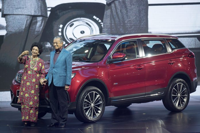 Malaysia Prime Minister Mahathir Mohamad (right) poses with his wife Siti Hasmah during the launch of Proton new SUV in Kuala Lumpur, Malaysia, Wednesday, Dec. 12. (AP Photo/Vincent Thian)