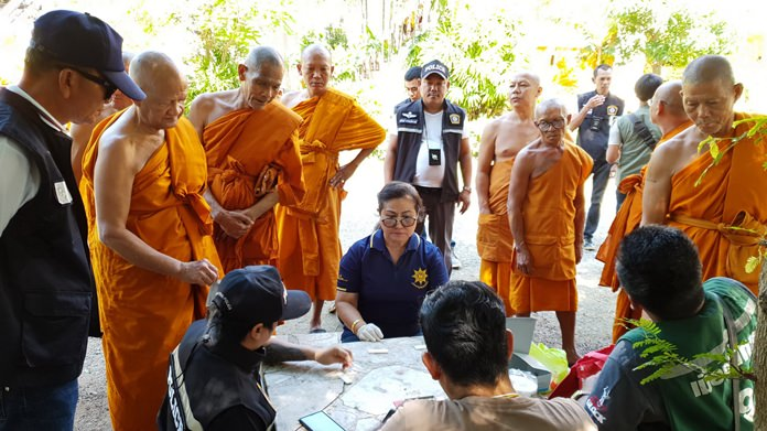 Sattahip District Chief Anucha Intasorn, police and village chiefs witness the Dec. 13 drug tests by 35 monks, all of whom passed.