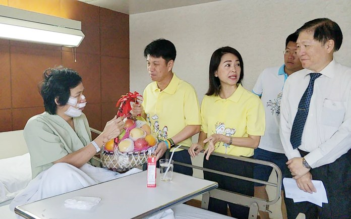 Chonburi governor Pakarathorn Thienchai and his wife Supaporn visit cyclists injured in the province's Ai Un Rak royal bike event.