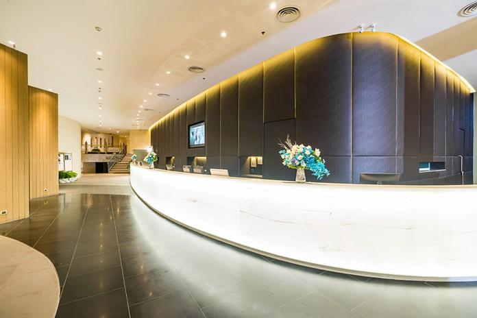 Three custom-designed, circular, translucent counters mark the hotel's entrance.
