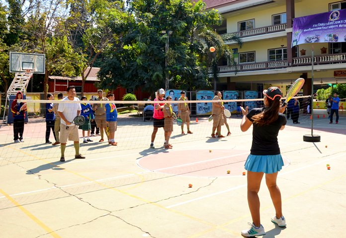 Learning how to play from a member of the Pattaya Tennis Lovers Club.