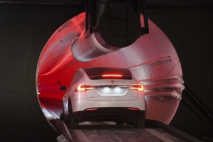 A modified Tesla Model X drives in the tunnel entrance before an unveiling event for the Boring Co. Hawthorne test tunnel in Hawthorne, Calif., Tuesday, Dec. 18. (Robyn Beck/Pool Photo via AP)