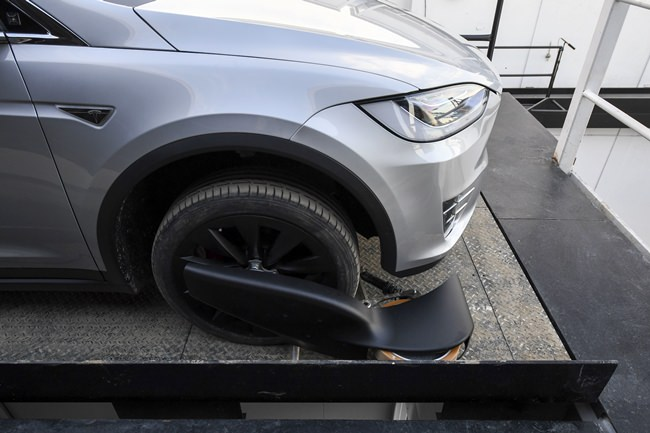 The modified Tesla Model X rests on an elevator above the pit and tunnel entrance. (Robyn Beck/Pool Photo via AP)