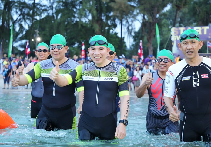 Navy commander-in-chief, Adm. Luechai Ruddit, takes to the water during the inaugural Royal Thai Navy Triathlon in Sattahip, Sunday, December 16.