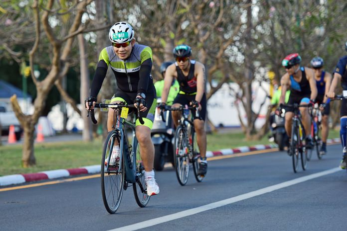 Athletes compete in the cycling discipline of the triathlon.