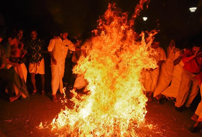 Protestors burn an effigy of Chief Minister Pinarayi Vijayan, reacting to reports of two women entering the Sabarimala temple, one of the world's largest Hindu pilgrimage sites, in Thiruvananthapuram, Kerala, India, Wednesday, Jan. 2. (AP Photo/R S Iyer)