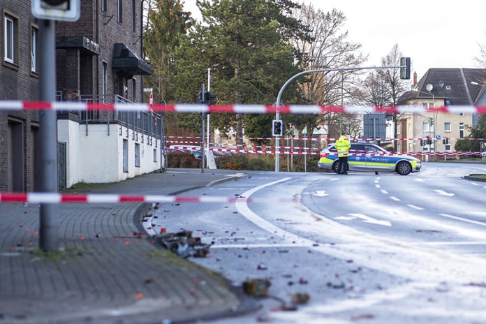 The Police block a road in Bottrop, Germany, Tuesday, Jan. 1. (Marcel Kusch/dpa via AP)