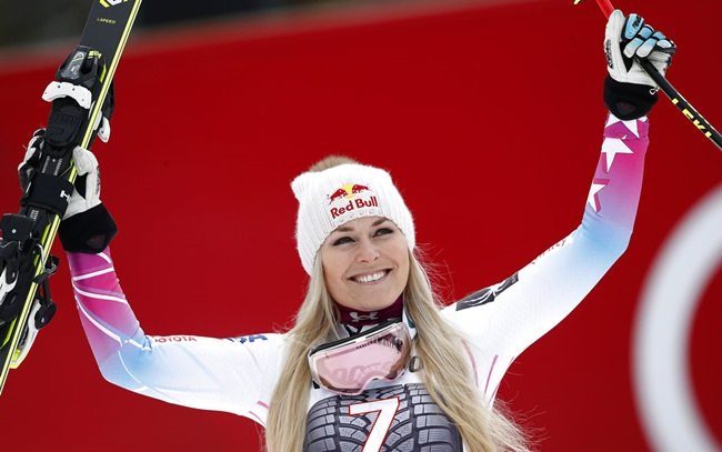 In this Feb. 4, 2018, file photo, United States' Lindsey Vonn celebrates on the podium after winning an alpine ski, women's world Cup downhill race, in Garmisch Partenkirchen, Germany. (AP Photo/Gabriele Facciotti)