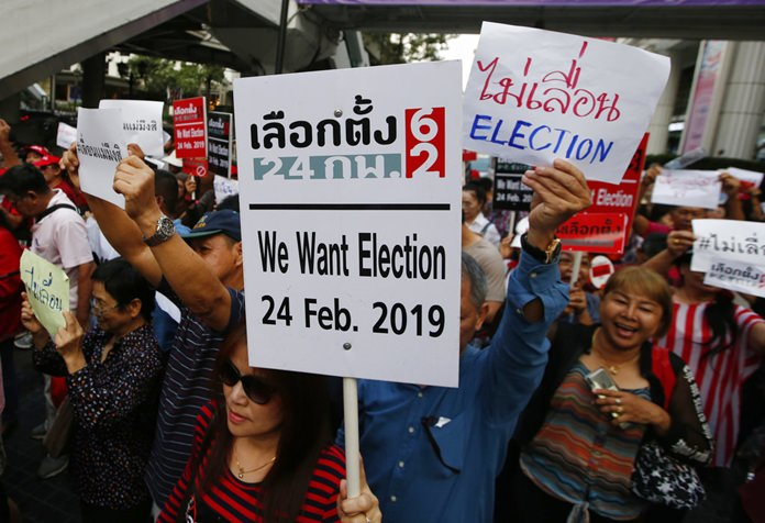 Demonstrators in Bangkok rally to demand the general election not be postponed, Tuesday, Jan. 8. (AP Photo/Sakchai Lalit)