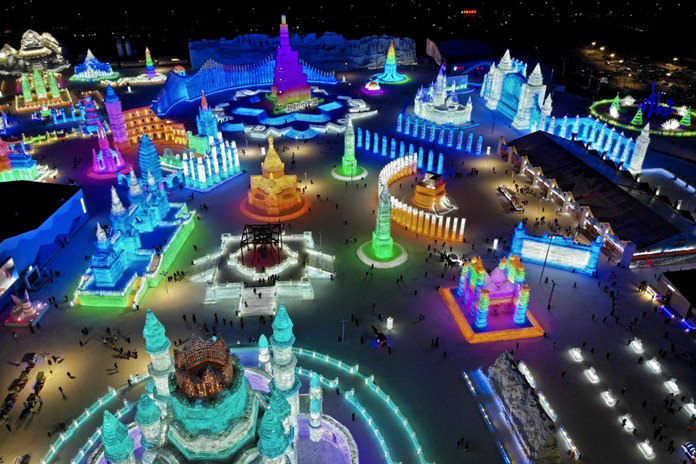 An aerial view taken with a drone shows the colorful building structures made from blocks of ice at the Harbin International Ice and Snow festival held in Harbin, China, Friday, Jan. 4.