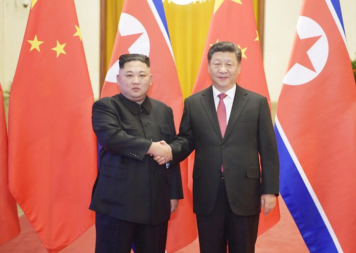 In this Tuesday, Jan. 8, 2019, photo, North Korean leader Kim Jong Un, left, and Chinese President Xi Jinping shake hands as they pose for a photo before talks at the Great Hall of the People in Beijing. (Li Xueren/Xinhua via AP)
