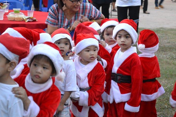 Little Santa's helpers line up to meet the big guy.