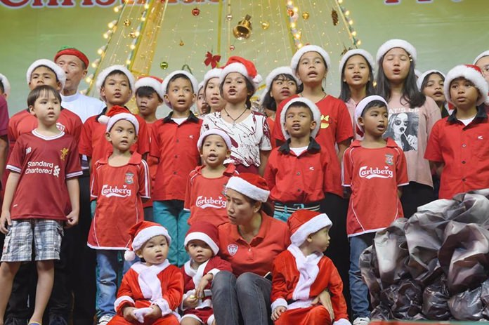 Youngsters sing with joy on this most memorable day.