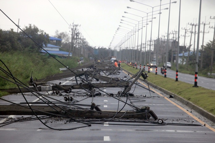 A row of toppled power lines from Tropical Storm Pabuk block a main highway, Friday, Jan. 4, 2019, in Pak Phanang, in the southern province of Nakhon Si Thammarat, southern Thailand. (AP Photo/Sumeth Panpetch)