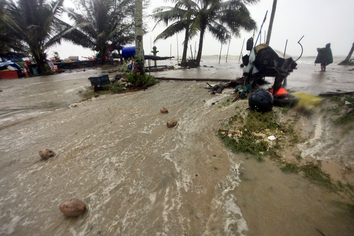 Floodwaters rise over a coastal road as Tropical Storm Pabuk strikes southern Thailand last weekend. (AP Photo/Sumeth Panpetch)
