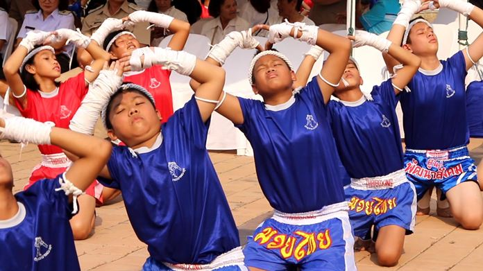 Banglamung students perform a Muay Thai pre-bout dance to pay homage to the legendary King Taksin on the 250th anniversary of his ousting of Burmese invaders from Ayutthaya.
