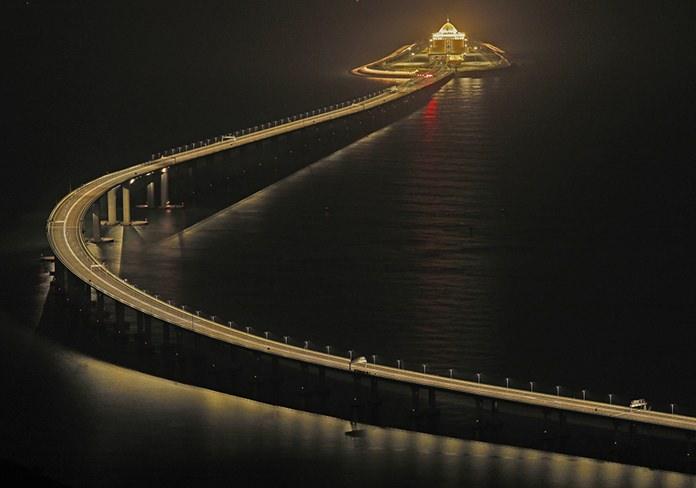 Hong Kong-Zhuhai-Macau Bridge, a total length of 55 kilometers (34 miles), is lit up in Hong Kong on Oct. 21, 2018. (AP Photo/Vincent Yu)