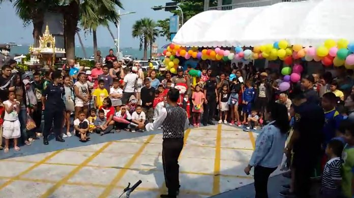 A juggler provides a Children's Day performance at Pattaya Police Station on Beach Road.