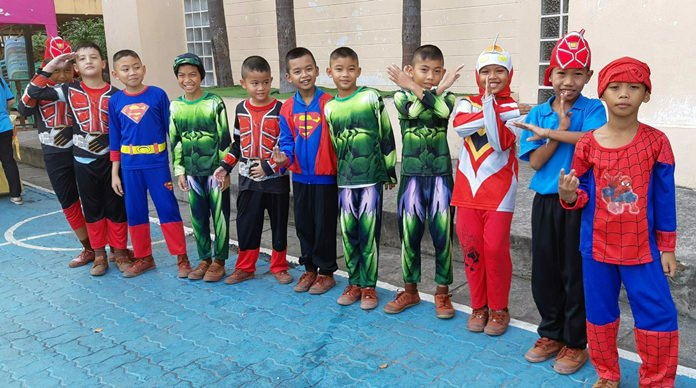 Tough guy heroes dress up as their favorite comic book defenders-of-the-good on Children's Day at Pattaya City School #9.
