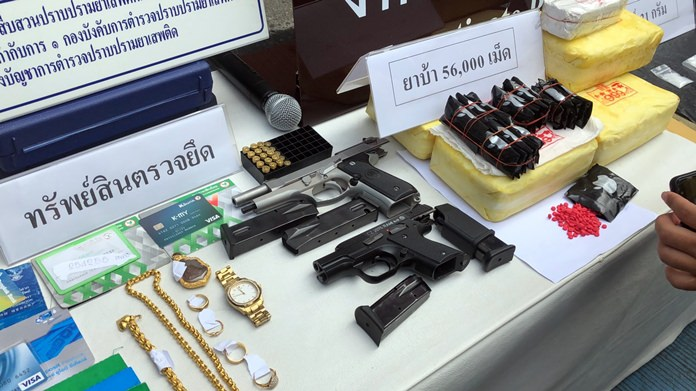Police confiscated 56,000 ya ba pills, two 9-mm. handguns, 20 bullets, two cellphones, three pickup trucks and a motorcycle during the arrest of a local dealer and two others.