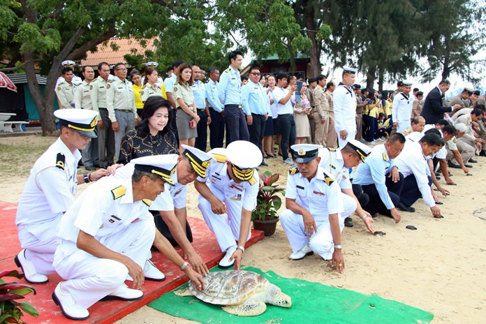 Rear Adm. Jatuporn Sukchaleam, deputy commander of the 1st Naval Area Command, leads sailors, residents and students to release sea turtles in honor of HRH Princess Sirivannavari Nariratana.