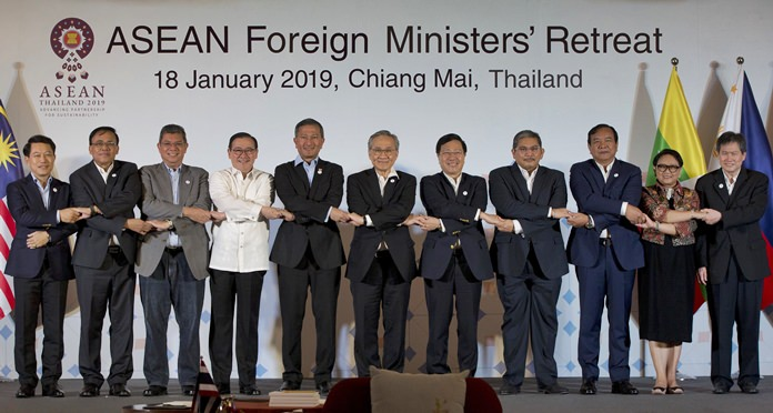 Foreign ministers of the Association of Southeast Asian Nations (ASEAN) join hands for a group photo during the ASEAN Foreign Ministers' retreat in Chiang Mai, Thailand, Friday, Jan. 18, 2019. They are from left to right, Laos' Saleumxay Kommasith, Myanmar's Kyaw Tin, Malaysia's Saifuddin Abdullah, Philippines Foreign Affaires Secretary Teodoro Locsin Jr., Singapore's Vivian Balakrishnan, Thailand's Don Pramudwinai, Vietnam's Phm Binh Minh, Brunei Second Minister of Foreign Affaires and Trade Erywan Yusof, Cambodia's Prak Sokhon, Indonesia's Retno Marsudi and ASEAN Secretary-General Dato Lim Jock Hoi. (AP Photo/Gemunu Amarasinghe)