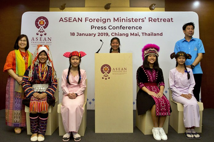 Thai school children in traditional tribal attire sit on cardboard chairs during a symbolic ceremony to receive cardboard school chairs made of recycled paper following the Association of Southeast Asian Nations (ASEAN) Foreign Ministers' retreat in Chiang Mai. (AP Photo/Gemunu Amarasinghe)