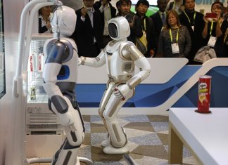 The Walker robot grabs a soda can during a demonstration at the Ubtech booth at CES International, Wednesday, Jan. 9, 2019, in Las Vegas. (AP Photo/John Locher)