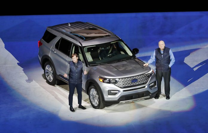 Ford Motor Co., President, Global Markets Jim Farley (left) and President and CEO Jim Hackett stand next to the redesigned 2020 Ford Explorer during its unveiling, Wednesday, Jan. 9, in Detroit. (AP Photo/Carlos Osorio)