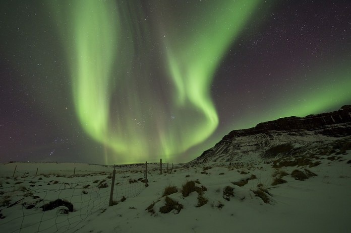 In this March 1, 2017 file photo, the Northern Lights, or aurora borealis, appear in the sky over Bifrost, Western Iceland. (AP Photo/Rene Rossignaud, File)
