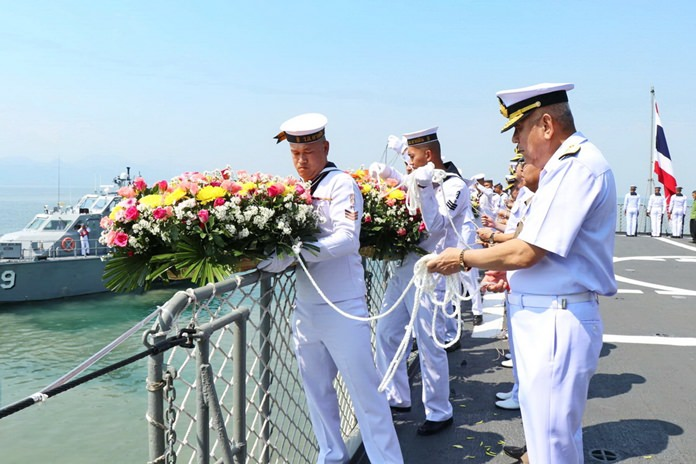 Adm. Noppadol Supakorn, commander-in-chief of the Royal Thai Fleet, prepares to float of a wreath in memory of the sailors aboard the coastal defense ship and two torpedo boats sunk by the Vichy French navy off Koh Lim before dawn on Jan. 17, 1941.