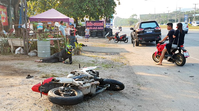 Two people were injured when they plowed their motorcycle into the side of an SUV making a U-turn in Sattahip.