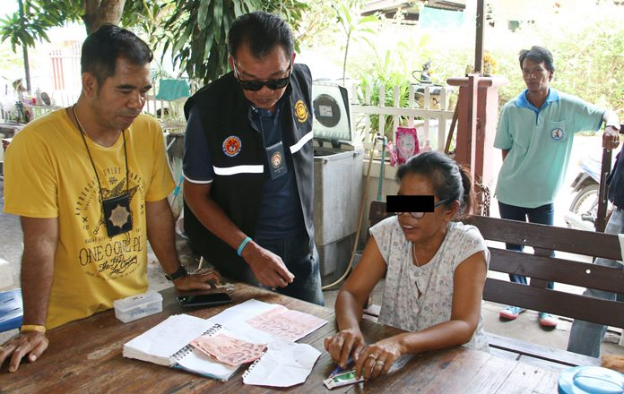 Taranee Auiaimsub was caught red-handed with illegal lottery tickets and the cash an informant used to buy them.