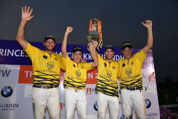 Malaysia's La Familia team members celebrate with the trophy after winning the 2019 Thai Polo Open championship.
