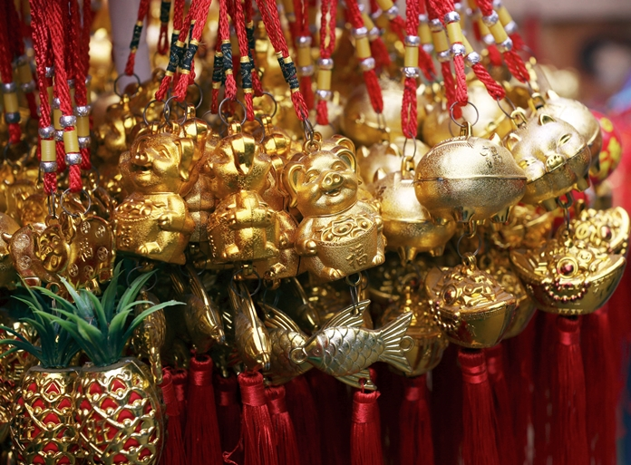 "Chinese New Year on Tuesday, February 5, marks the Year of the Earth Pig, the last animal in the Chinese zodiac. Every year, 130 million migrant workers in China make their way home for New Year celebrations creating the world's largest human migration. Many events are planned here in Pattaya, a list of which can be found on page 2. Gong Hei Fat Choy is the traditional greeting in Cantonese, which is spoken in parts of southern China and Hong Kong. It directly translates to ""wishing you great happiness and prosperity."" In Mandarin, the official language of China, the same greeting is ""Gong Xi Fa Cai"" (pronounced gong she fa tsai). Whichever you prefer, we at Pattaya Mail wish you a most healthy, happy and prosperous Chinese New Year. (AP Photo/Achmad Ibrahim)"