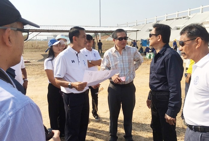 Deputy Mayor Pattana Boonsawat and local officials inspect the progress on the Eastern National Sports Complex's proposed 20,000-seat football stadium.