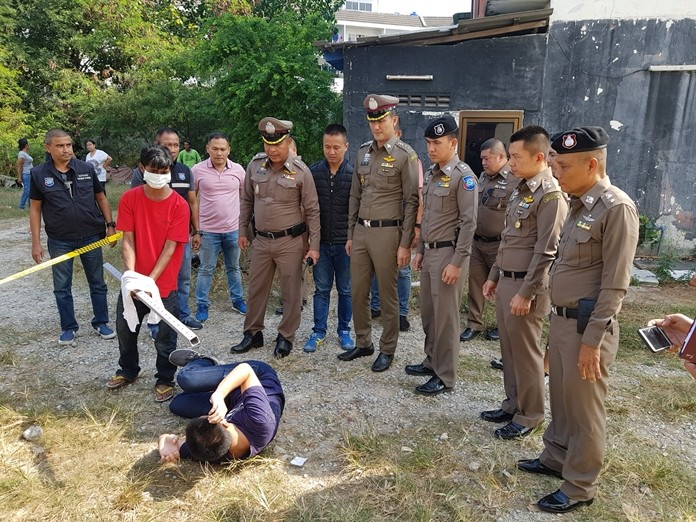 Muang Ram re-enacts his role in the killing of Dua Ka Paya behind a commercial building in Soi Yensabai in South Pattaya.