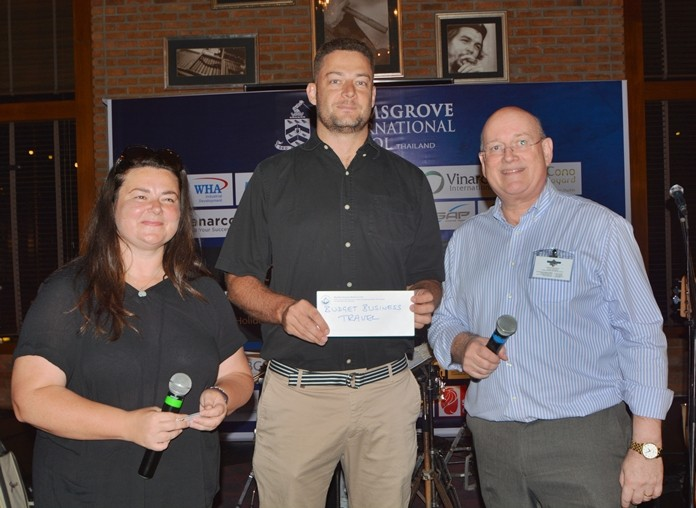 Christine Armstrong from Bromsgrove International School presents ASAP Marine Trading MD Berne Lamprecht (centre) with his raffle prize.