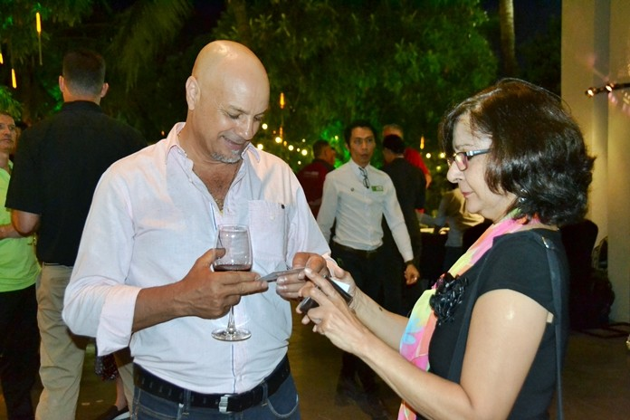 Majic Beauty Cosmetics MD Rocky Mammone and Pattaya Mail's Sue Kukarja exchange business cards.