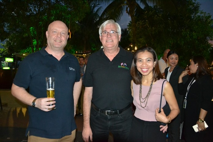 Adam Beechinor, GM Sirva Thailand, Frank Holzer, Executive General Manager of MHG Thailand Co., Ltd., and his charming partner.