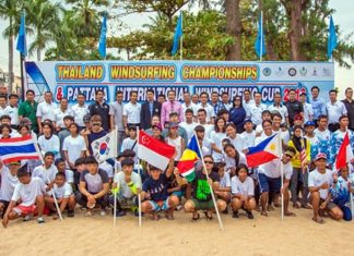 Sailors from nine countries pose for a group photo during the Thailand Windsurfing Championships held at Jomtien Beach in Pattaya from January 17-20.