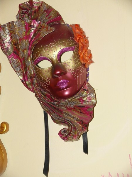 Take in the décor, complete with Viennese masks and a 'rogues gallery'.