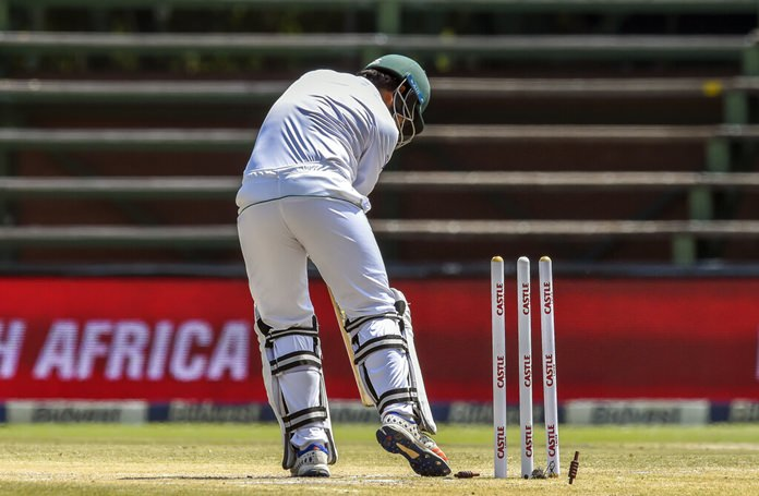 Pakistan's Sarfraz Ahmed is bowled out for 0 on day four of the third cricket test match between South Africa and Pakistan at Wanderers Stadium in Johannesburg, South Africa, Monday, Jan. 14. (AP Photo/Christiaan Kotze)