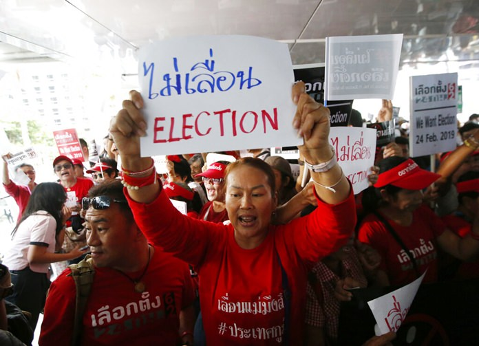 In this Tuesday, Jan. 8, 2019, file photo, demonstrators hold a rally demanding the general election not be postponed in Bangkok. (AP Photo/Sakchai Lalit)