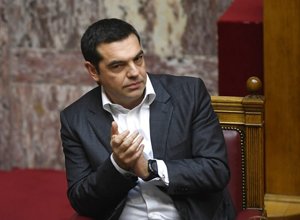 Greece's Prime Minister Alexis Tsipras applauds during a parliament debate about the Prespa Agreement in Athens, Friday, Jan. 25. (AP Photo/Michael Varaklas)
