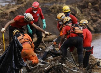 Firefighters pull a body from the mud days after a dam collapse in Brumadinho, Brazil, Monday, Jan. 28. (AP Photo/Leo Correa)