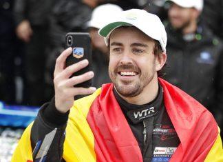Fernando Alonso, of Spain, takes a selfie photo in Victory Lane after winning the IMSA 24 hour race at Daytona International Speedway, Sunday, Jan. 27, in Daytona Beach, Fla. (AP Photo/John Raoux)